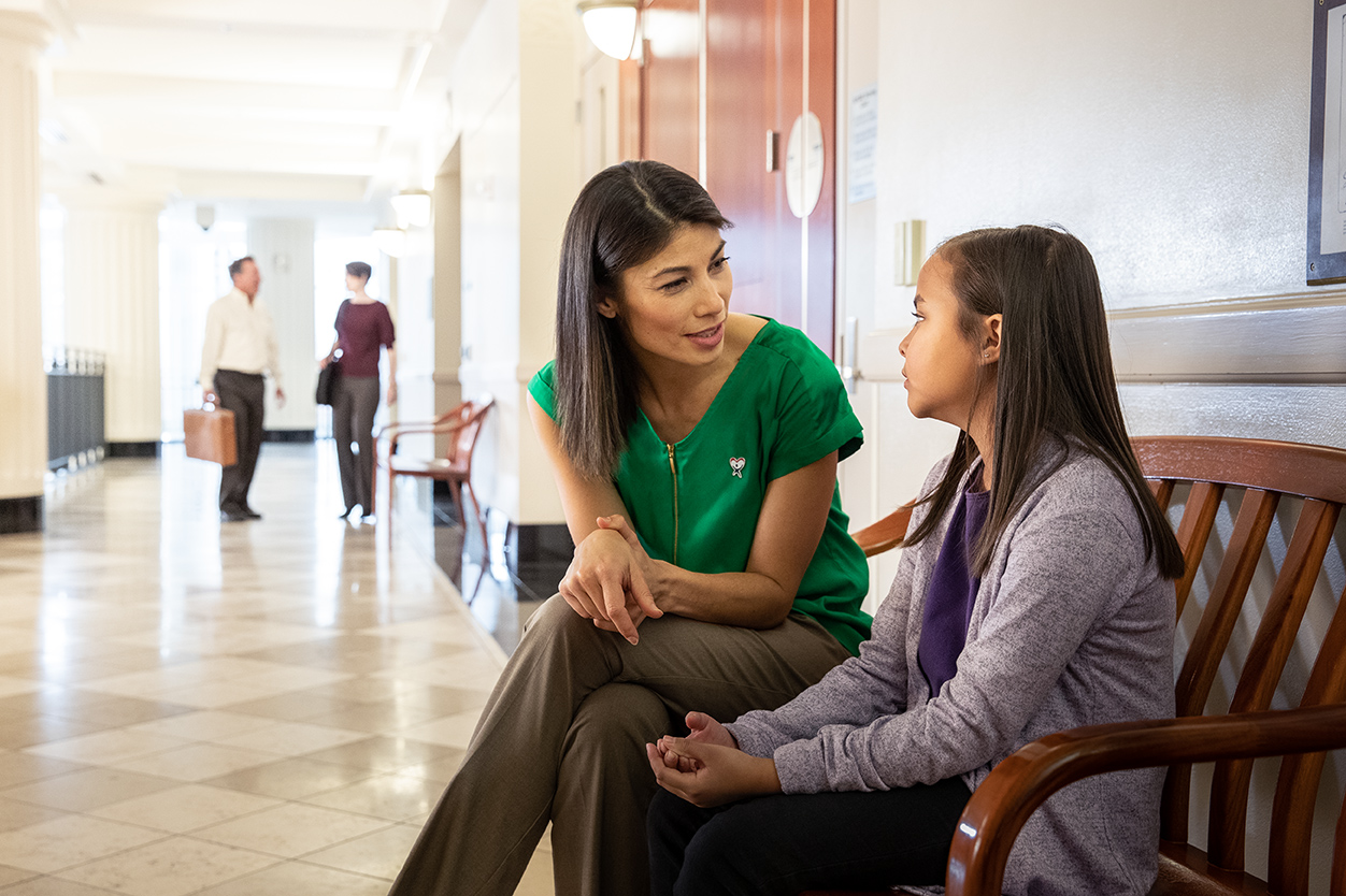 A CASA volunteer answers questions from a child she is advocating for.
