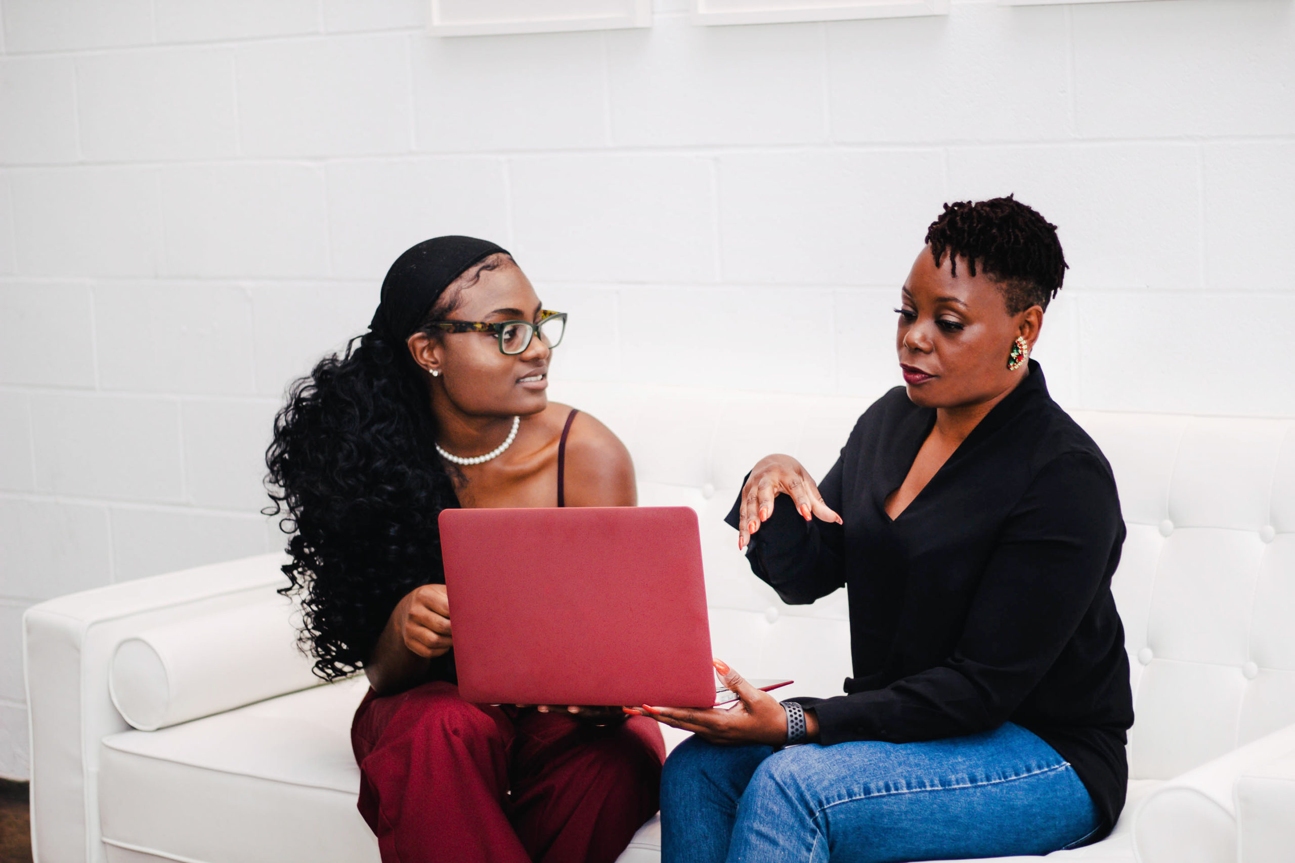 Two women discuss organiational racial equity.
